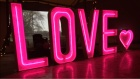 ina-tipi-pink-neon-light-up-love-letters-with-pink-heart-on-top.jpg